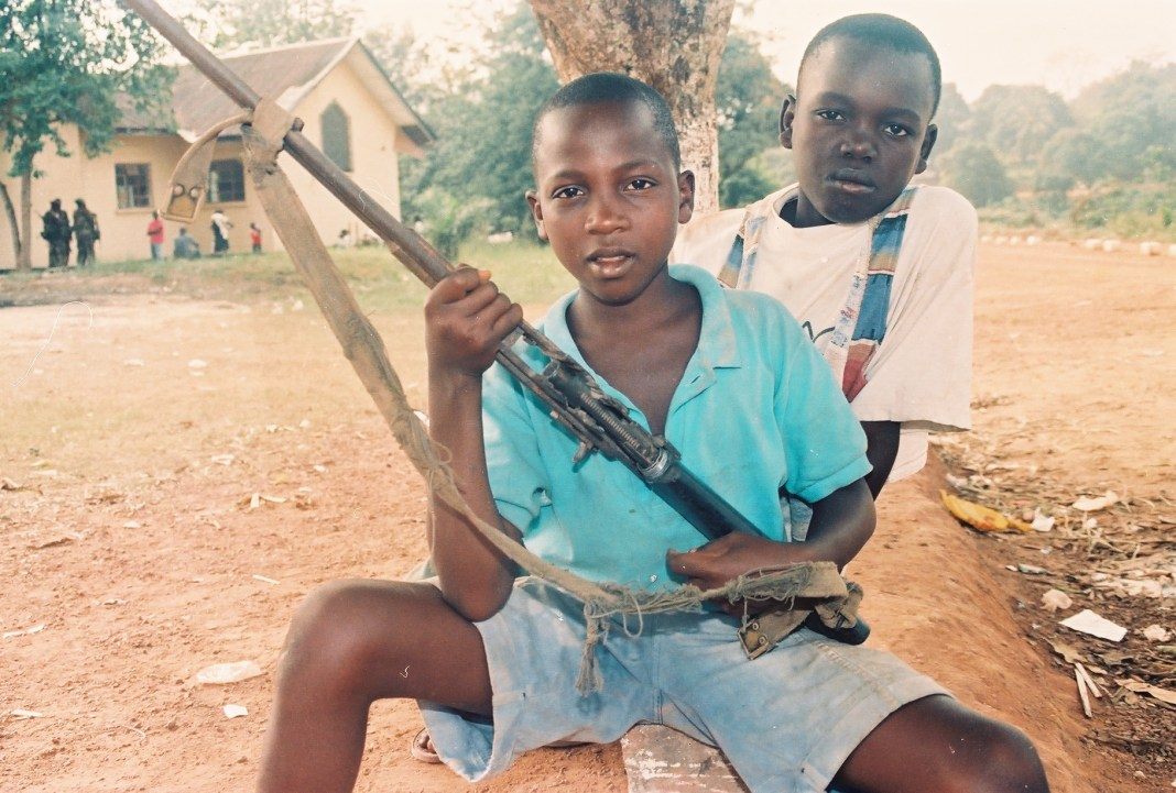 Child Soldier in Liberia. Photo: The AfricaPaper/ James k. Fasukoi