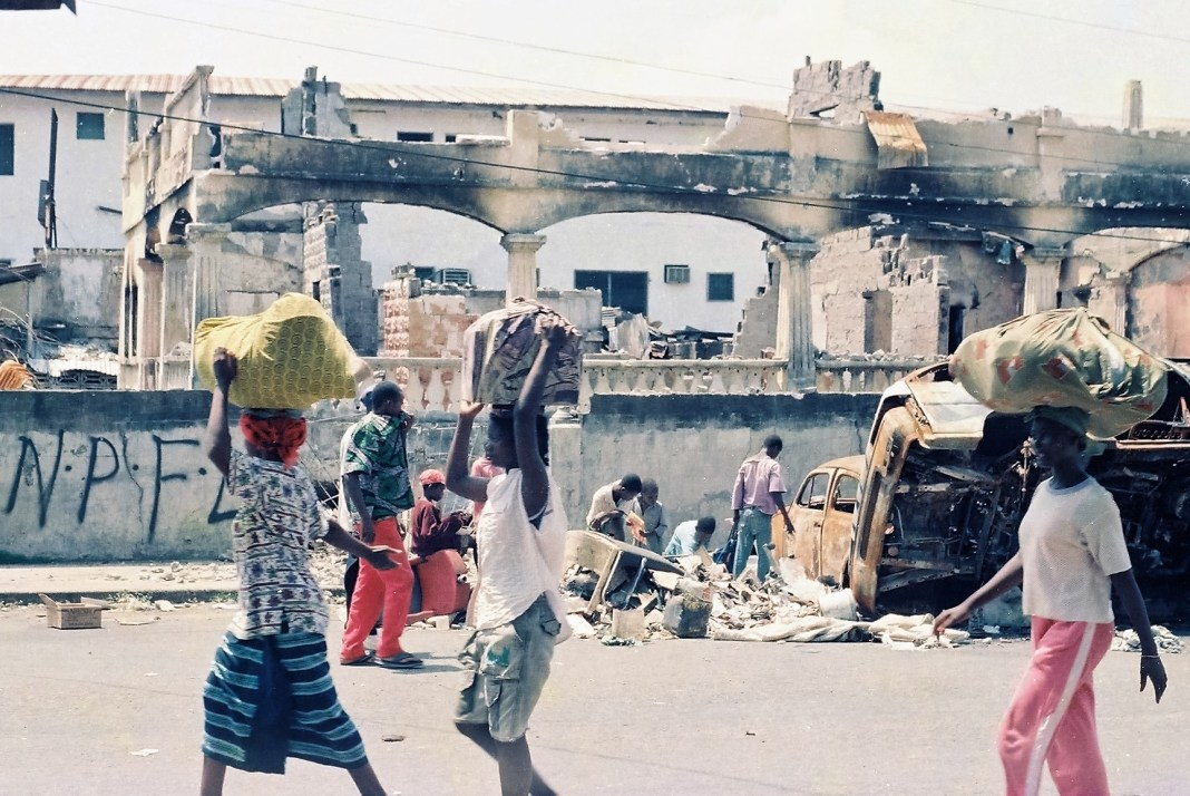 Civilians fled Monrovia as NPFL destroyed the city. Photo: James K. Fasuekoi/The AfricaPaper