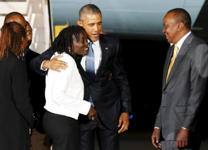 Former US president Obama hugs sister Dr. Auma as President Kenyatta looks on. Photo: Henry Owino/The AfricaPaper