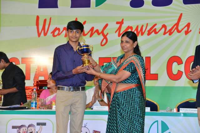 Ms. Meenaxiben Patel  giving special awards to students of Aloha Gujarat who have secure place in Limca book of records for different categories of Mental Arithmetic.