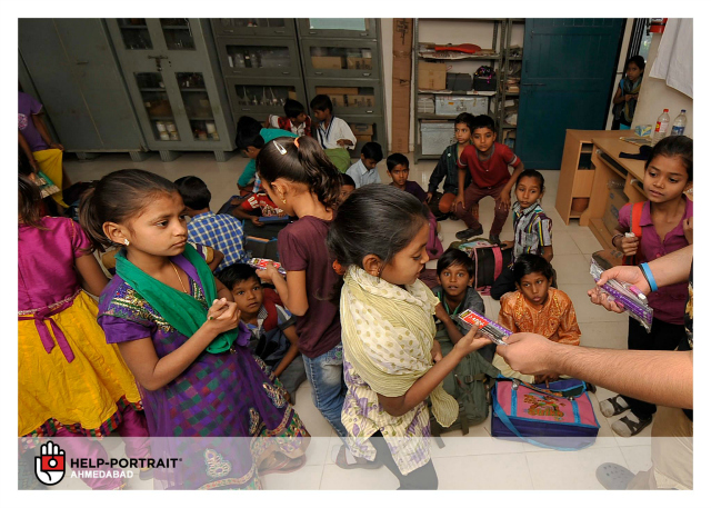 Help-Portrait Ahmedabad 2013: Children receiving the school supplies