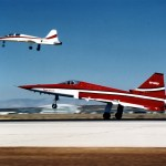 The first F-20 built takes off with a T-38 chase plane (background) (U.S. Air Force photo)