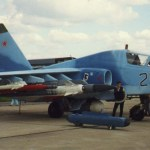 "Russian Su-25TM. Carries (from tip to fuselage) R-73, R-77, 8*Vikhr, Kh-29T, Kh-58. White dome of ""Kopyo"" radar container is seen below, while two Omul ECM pods lie beside the aircraft."