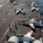 T-45 Goshawk training aircraft are staged on the flight deck of the USS Theodore Roosevelt during flight qualifications off the coast of Virginia. (US Navy photo)