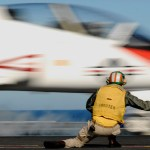 A shooter launches a T-45 Goshawk training aircraft assigned to Carrier Training Wing (CTW) from the aircraft carrier USS Abraham Lincoln in 2008 (US Navy photo)