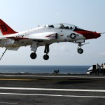 Landing signal officers watch a T-45A Goshawk training aircraft assigned to Training Squadron (VT) 7 land aboard the aircraft carrier USS George H.W. Bush in 2010 (US Navy photo)