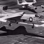 A U.S. Navy Vought F-8H Crusader of U.S. Naval Reserve fighter squadron VF-202 Superheats landing on the aircraft carrier USS John F. Kennedy during carrier qualifications in 1971 (US Navy photo)