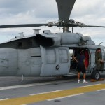 Side view of MH-60 with pilot visible. This aircraft is not stationed on the Wasp, but was parked there during Fleet Week and Independence Day festivities (Air Cache Photo/John M. Guilfoil)