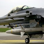"""US Air Force F-16C """"Fighting Falcon"""" armed with AIM-120 Advanced Medium Range Air-to-Air Missiles (AMRAAM), AIM-9 Sidewinder missiles and AGM-88 High Speed Antiradiation Missile (HARM) taxies onto the flight line at Incirlik Air Base (AB), Turkey, for a mission in support of Operation NORTHERN WATCH."""