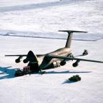Air Force Cargo is unloaded from a C-5B Galaxy aircraft following its landing on the ice runway near McMurdo Station during Operation DEEP FREEZE '90. The Galaxy is the second such aircraft to land on the runway, which is over 10,000 feet long and was scraped from ice over eight feet deep.