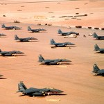 F-15E Eagle fighter aircraft of the 4th Tactical Fighter Wing, Seymour Johnson Air Force Base, N.C., are parked on an air field during Operation Desert Shield.