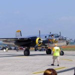 """A B-25 """"Mitchell"""" named """"Miss Hap"""" taxiing for takeoff. The B-25 gained game in the Doolittle Raid after the attack on Pearl Harbor (Air Cache photo/John M. Guilfoil)"""