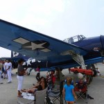 """A Grumman TBF """"Avenger"""" torpedo bomber seen at the 2012 Great New England Airshow at Westover Air Reserve Base. Crowds enjoyed the shade provided by its wings. (Air Cache photo/John M. Guilfoil)"""
