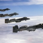 Four A-10 Thunderbolt IIs from the 111th Fighter Wing of the Pennsylvania Air National Guard fly in formation during a refueling mission