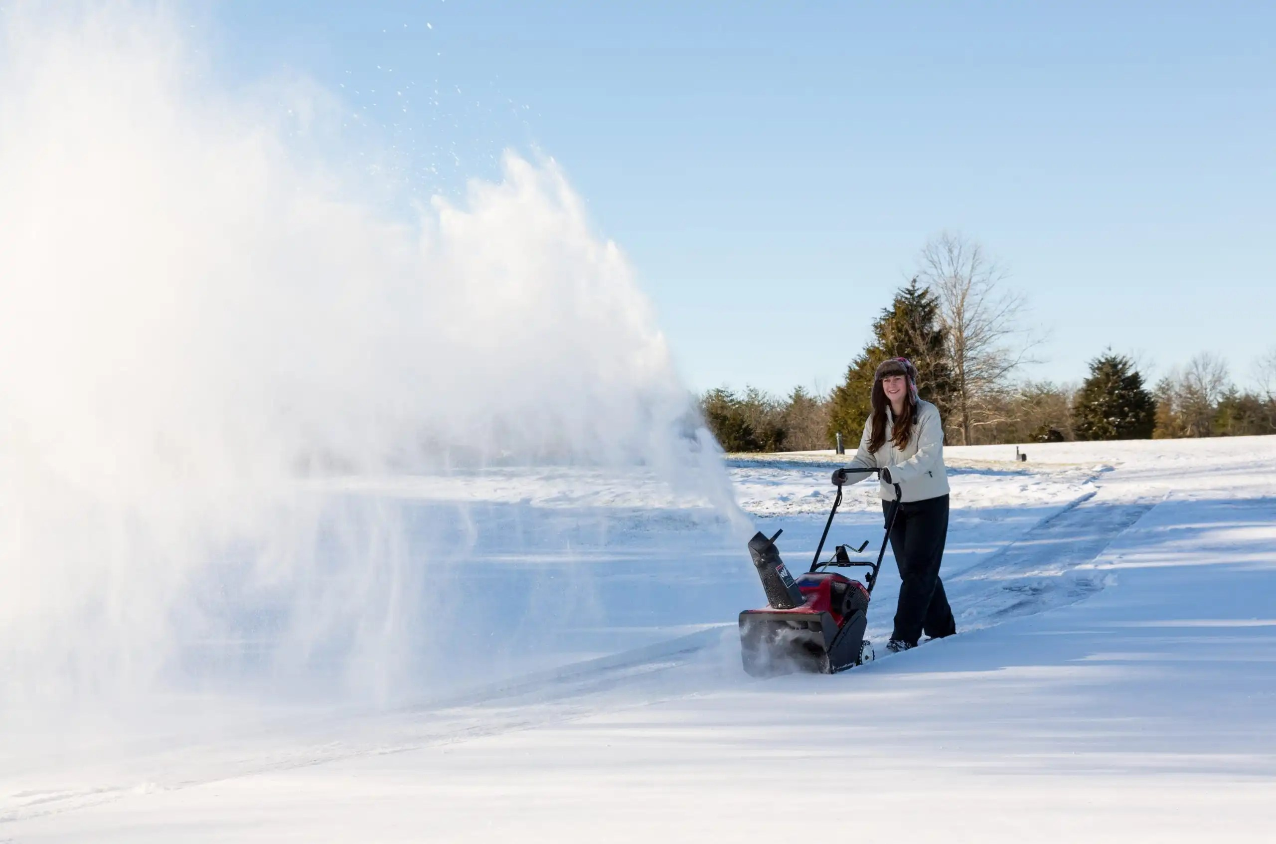 using battery powered snowblower on driveway