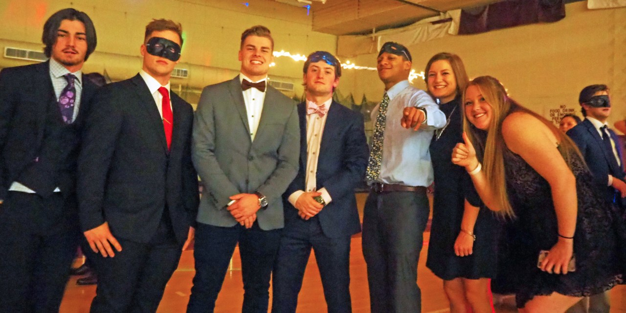 Students celebrate at athletic formal