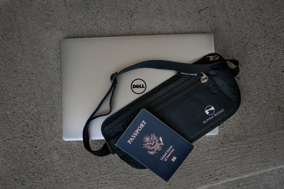 Adventure travel packing list electronics and passport.