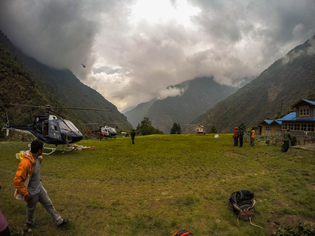 The grass field of Surkey, near Lukla. This field is one of the many places you can take a helicopter from when leaving the Everest Base Camp Trek.