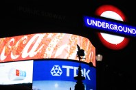 The Eros statue, silhouetted against the bright advertising lights in London's Piccadilly Circus and the Iconic London Underground sign in the foreground!