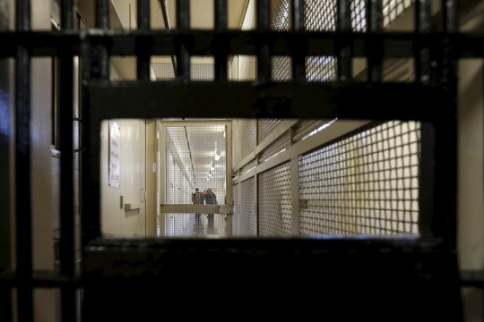 Members of the media walk down the corridor inside the Adjustment Center during a media tour of California's Death Row at San Quentin State Prison in San Quentin, California December 29, 2015. America's most populous state, which has not carried out an execution in a decade, begins 2016 at a pivotal juncture, as legal developments hasten the march toward resuming executions, while opponents seek to end the death penalty at the ballot box.