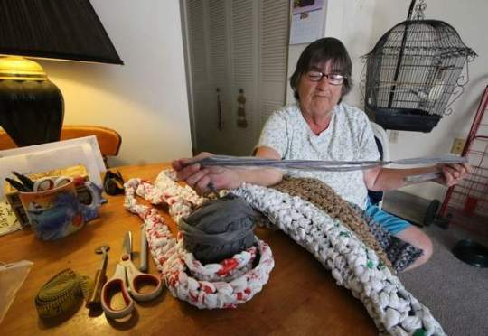 Virgina Wingate crochets sleeping mats for homeless people out of plastic grocery bags in her Daytona Beach apartment.