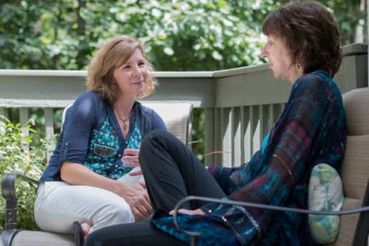 Death doula Shelby Kirillin chats with client Kim McGaughey.