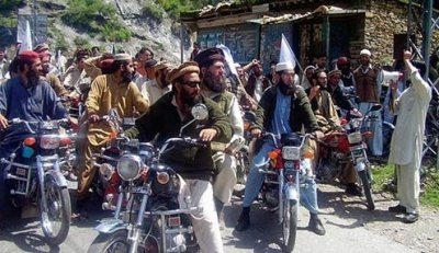 Supporters of Islamic law on Thursday in the Swat Valley, a Pakistani region where the Taliban exploited class rifts to gain control.