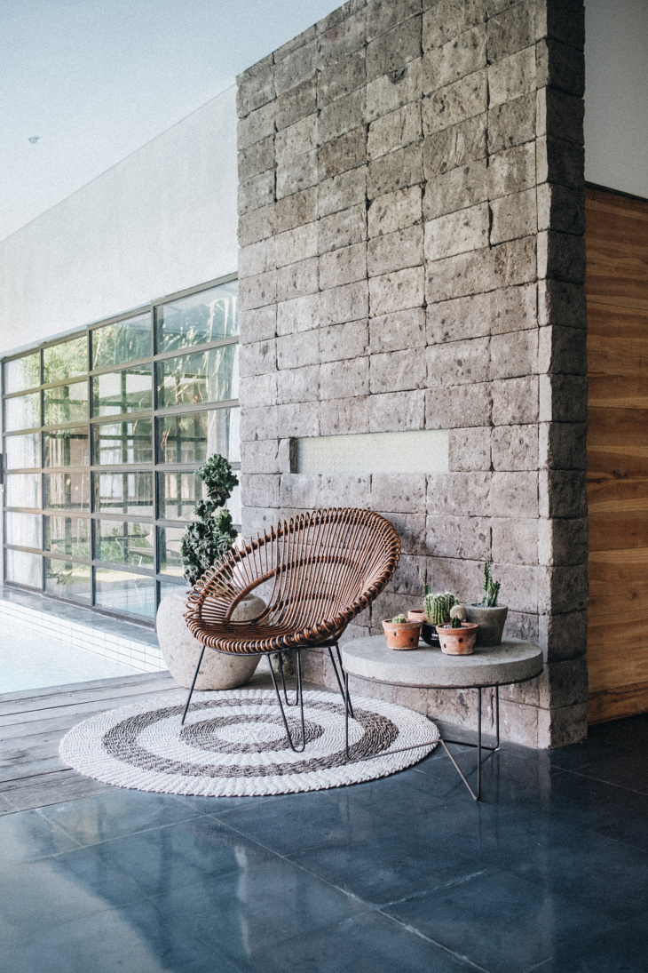 modern scando, stone wall and cane chair