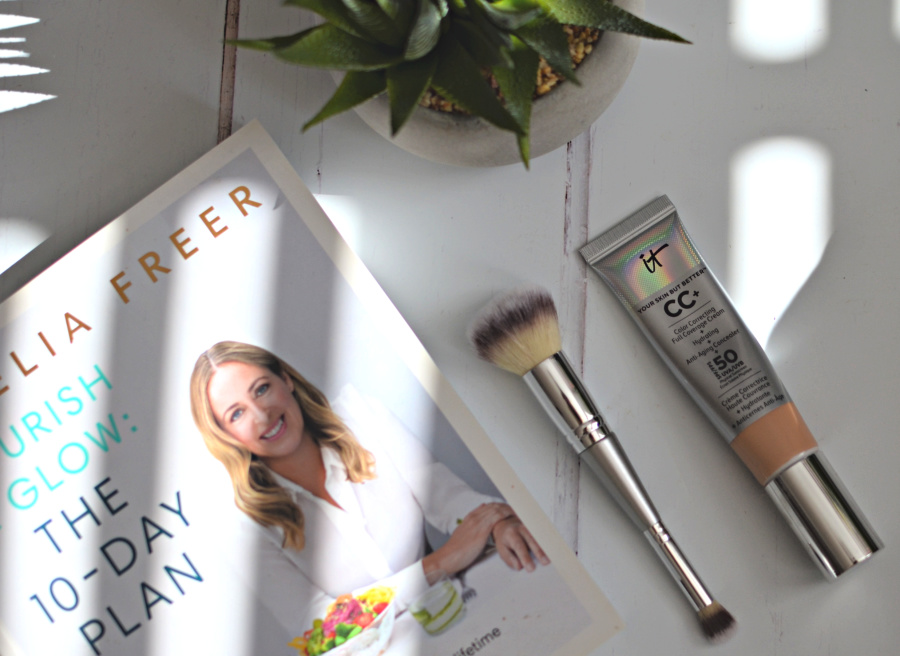 a tube of foundation and a brush