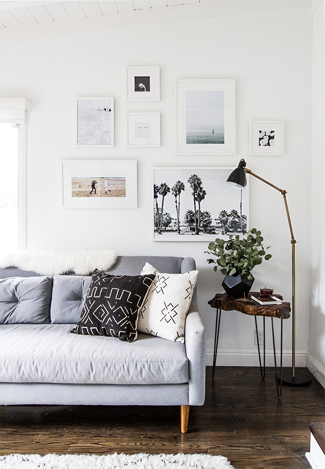 Small Living Room Ideas: Gallery walls with a mix of art prints and wall accents will make a statement that everyone will notice when they walk into your apartment living room. But, if you're looking for simplicity, find an element in a print, or piece of art that you love and make it the common theme in your aesthetic.