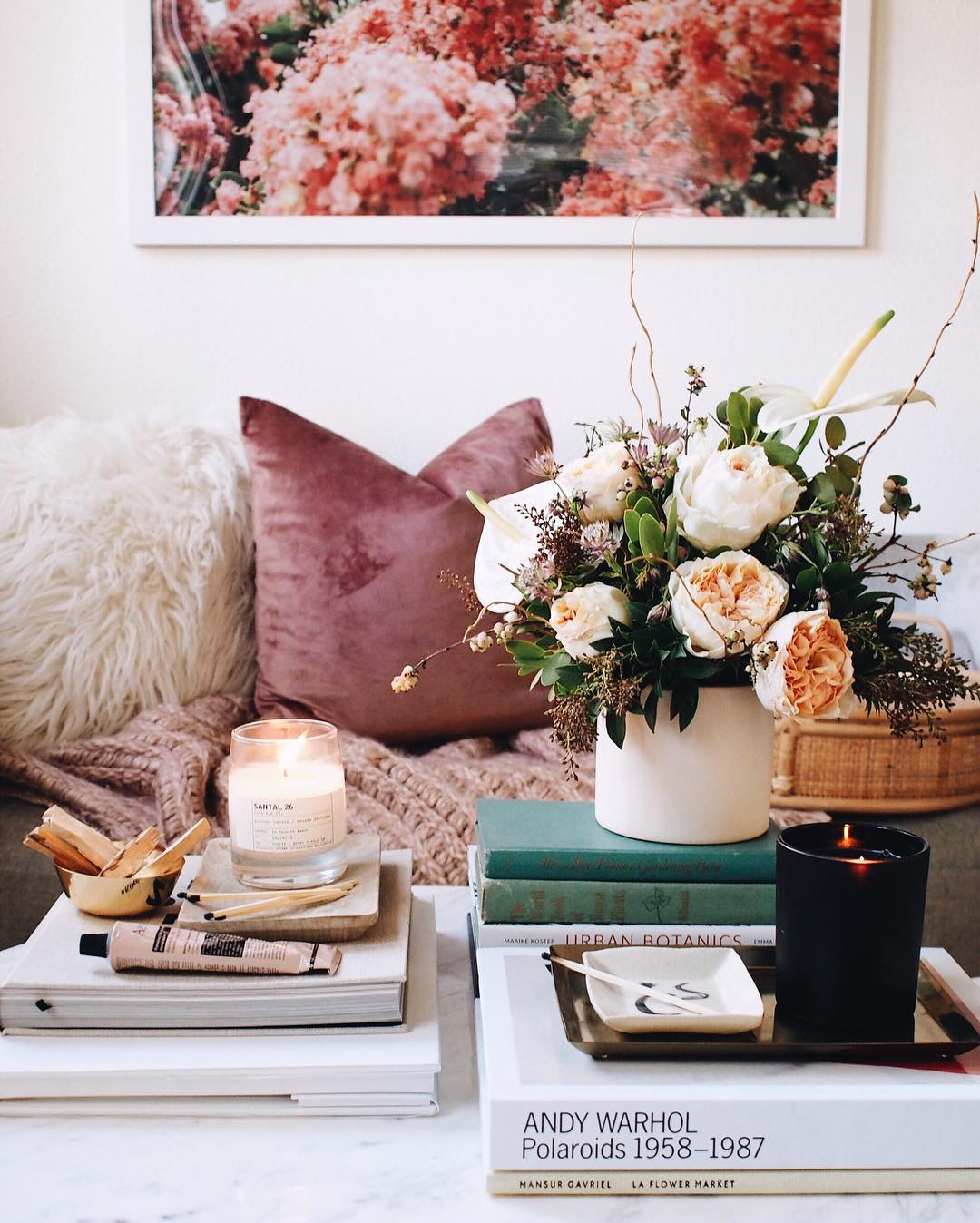 Studio Apartment Ideas: A coffee table can be the perfect stage for your favorite books, candles, and plants. A curated coffee table arrangement will show off your style and tie the room together. If you're looking for something non-traditional, vintage trunks, crates, wood slabs, and tree stumps make excellent alternatives.