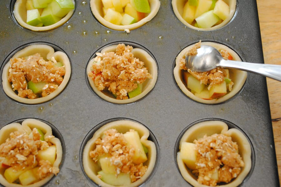 Top each tart with a heaping teaspoon of the crisp topping.