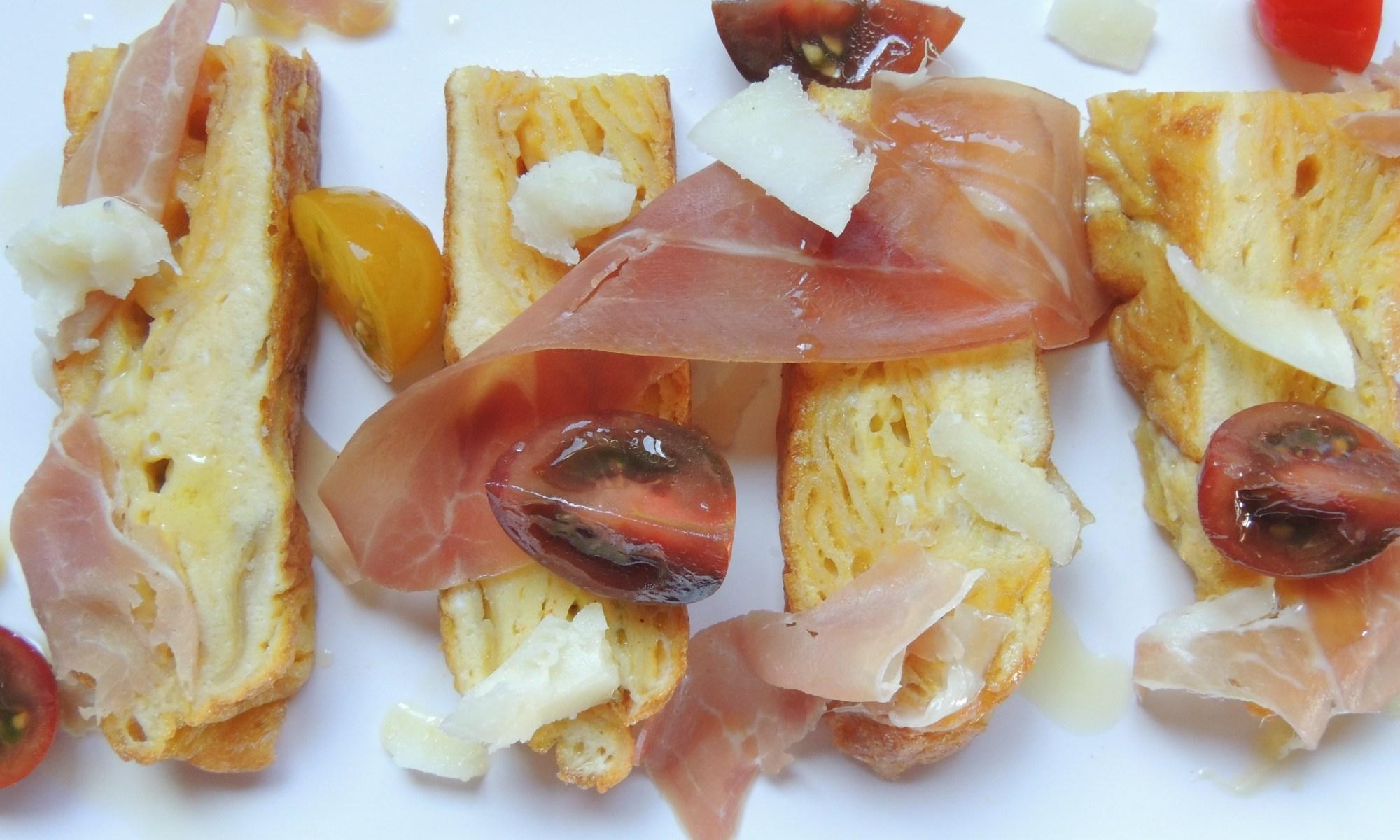 Potato chip omelette with prosciutto, tomato and manchego cheese
