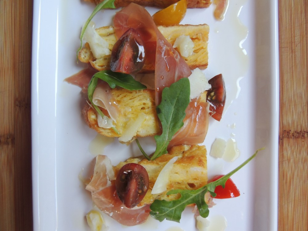 Spanish Tortilla with Prosciutto tomato, arugula and manchego