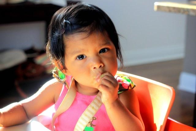 Asha eating grapefruit
