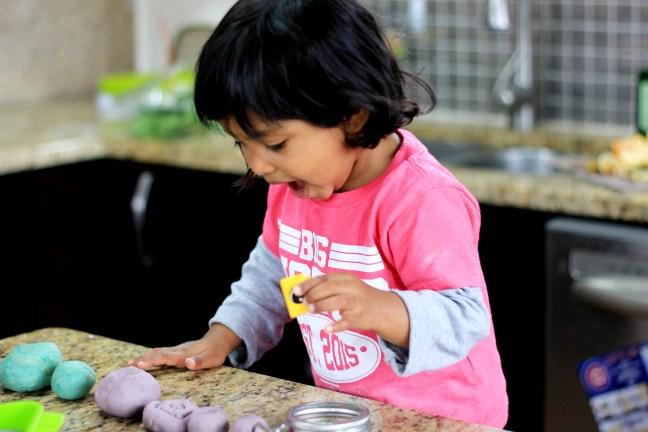 Asha playing with homemade play dough