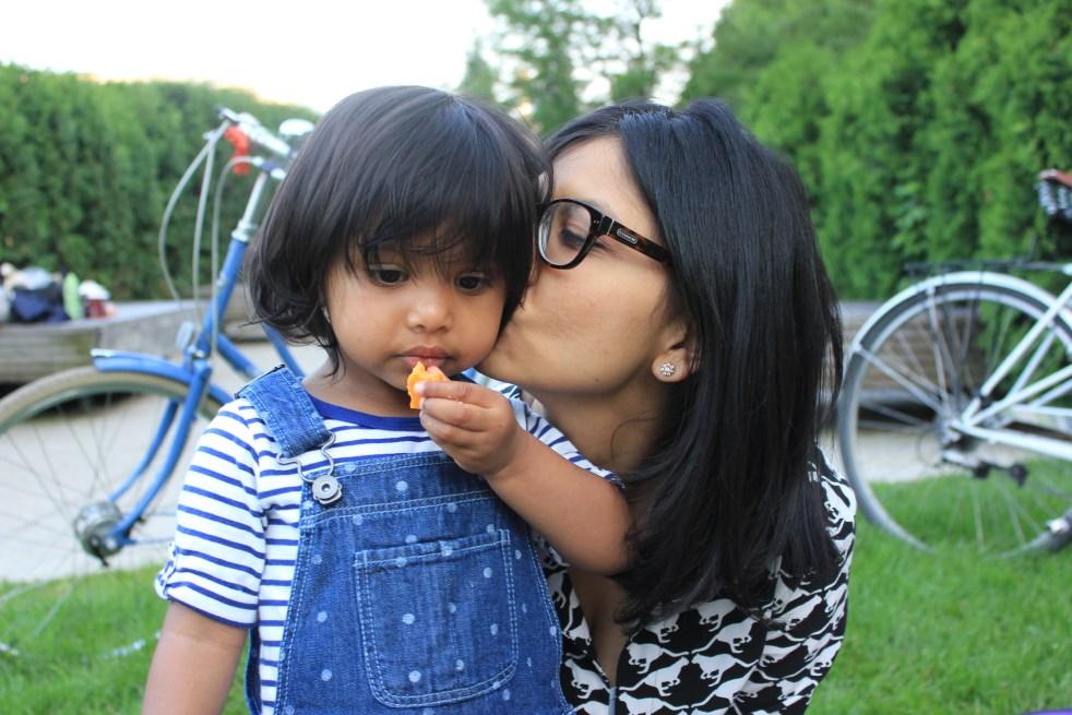 mommy kissing Asha in Millennium Park