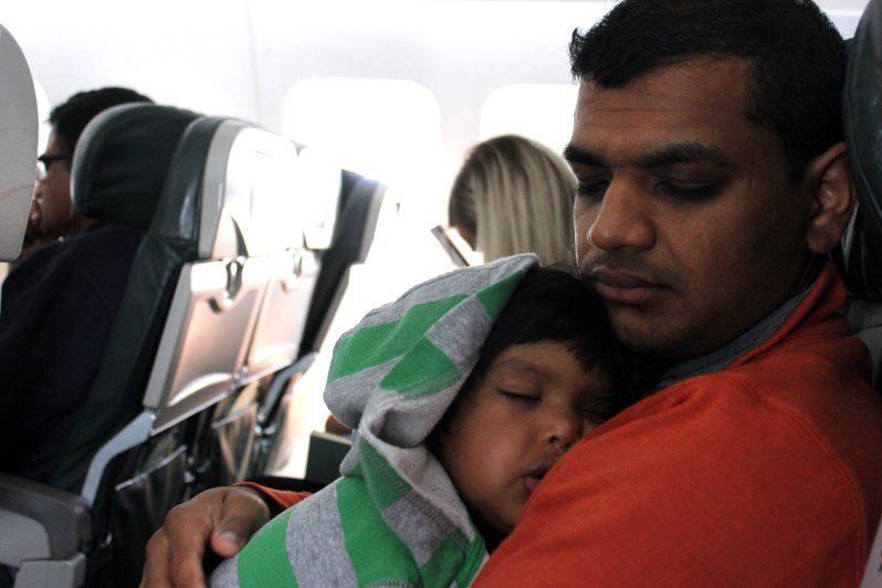 Asha and Devang sleeping on plane