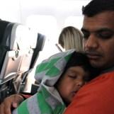 Asha and Devang sleeping on plane