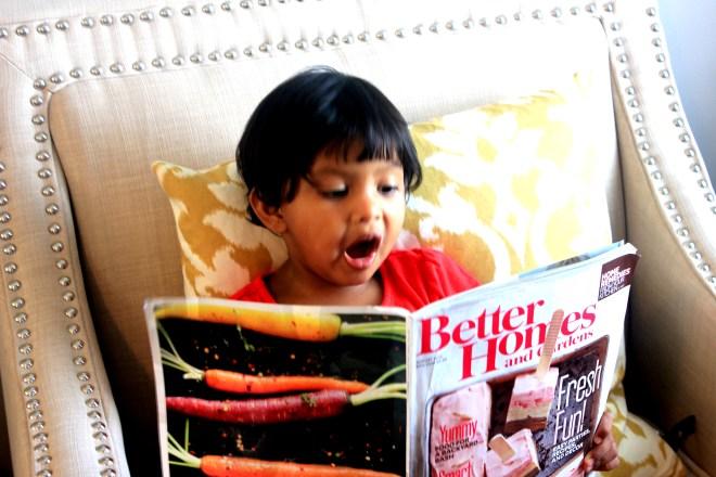 Asha reading Better Homes