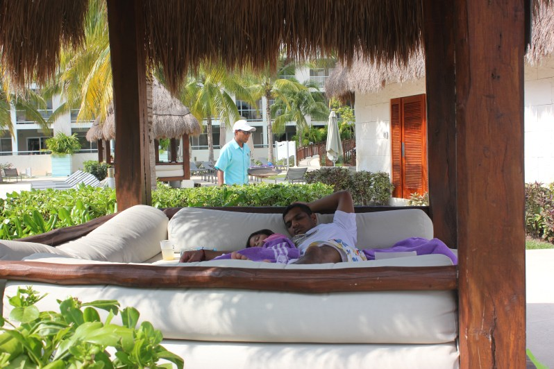 Asha and Arjun napping in a palapa by the pool in Paradisus playa del carmen, Mexico