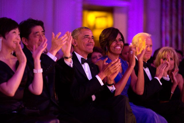 "President Barack Obama and First Lady Michelle Obama, with Prime Minister Shinzo Abe of Japan, First Lady Akie Abe, Vice President Joe Biden and Dr. Jill Biden, applaud the cast of ""Jersey Boys"" during the State Dinner performance in the State Dining Room of the White House, April 28, 2015. (Official White House Photo by Pete Souza) This official White House photograph is being made available only for publication by news organizations and/or for personal use printing by the subject(s) of the photograph. The photograph may not be manipulated in any way and may not be used in commercial or political materials, advertisements, emails, products, promotions that in any way suggests approval or endorsement of the President, the First Family, or the White House."