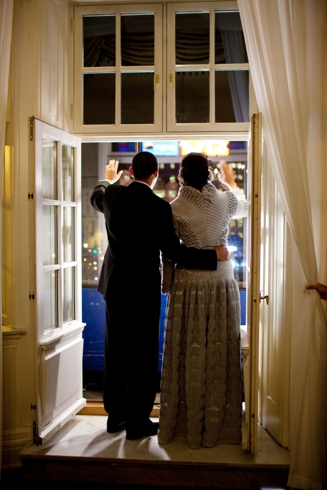 President Barack Obama and First Lady Michelle Obama wave from a balcony at the Grand Hotel as they greet the Torch Parade in Oslo, Norway, Dec. 10, 2009. (Official White House Photo by Pete Souza) This official White House photograph is being made available only for publication by news organizations and/or for personal use printing by the subject(s) of the photograph. The photograph may not be manipulated in any way and may not be used in commercial or political materials, advertisements, emails, products, promotions that in any way suggests approval or endorsement of the President, the First Family, or the White House.