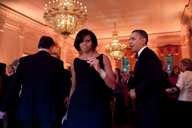 "Feb. 21, 2010 ""The President and First Lady were dancing along to the music of the Harry Connick, Jr., Big Band at the Governors Ball. Mrs. Obama turned towards me and, for one split second, looked right at me. Usually I strive to capture moments when the subjects are unaware of the camera. But this an exception where I actually liked that she was looking at me."" (Official White House Photo by Pete Souza) This official White House photograph is being made available only for publication by news organizations and/or for personal use printing by the subject(s) of the photograph. The photograph may not be manipulated in any way and may not be used in commercial or political materials, advertisements, emails, products, promotions that in any way suggests approval or endorsement of the President, the First Family, or the White House."