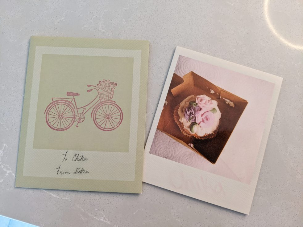 A card with a bike envelope and a cupcake picture