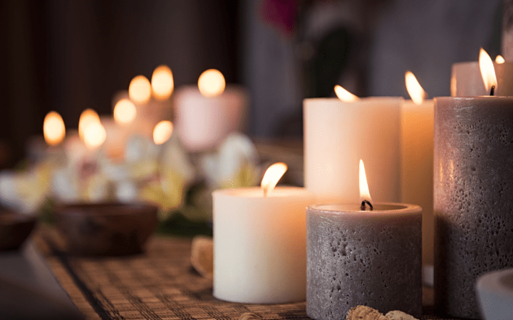 Lamps, fairy lights, and candles all create pockets of coziness throughout your apartment, an essential for cottagecore apartment style.
