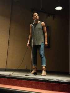Cara Hagan delivering her poem.