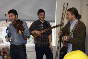 "Bluegrass band ""Major Sevens"" preforming at the Watauga County Public Library before the start of the parade. From left to right: Drayton Aldridge, Brooks Forsyth and Lucas Triba"
