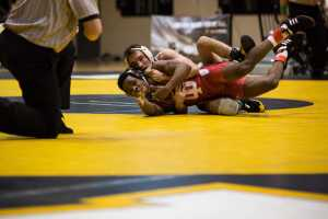 App State's Vito Pasone attempts to pin his opponent during his 7-5 loss.