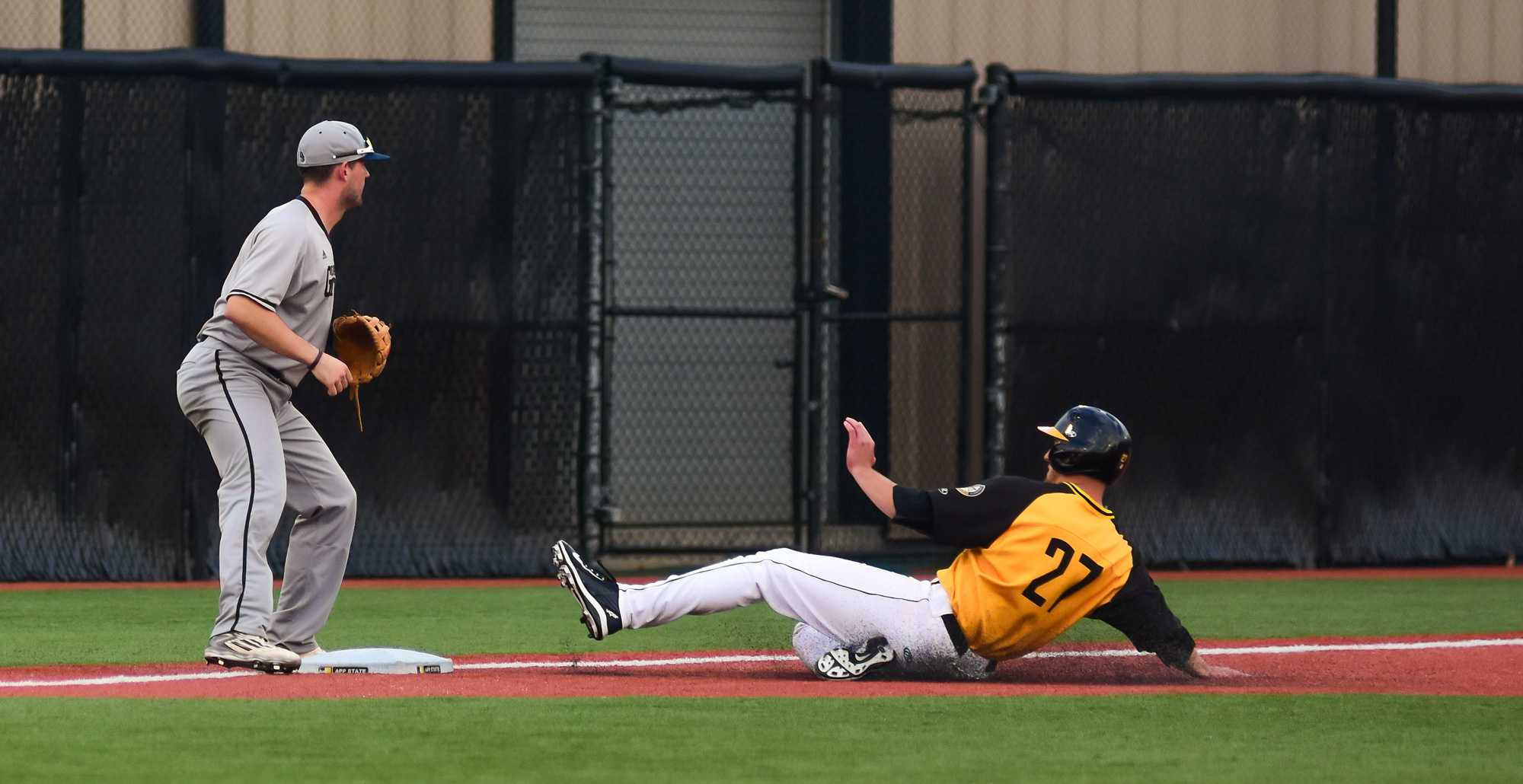 Senior infielder Grayson Atwood slides to third base. Photo by Dallas Linger, Photo Editor.
